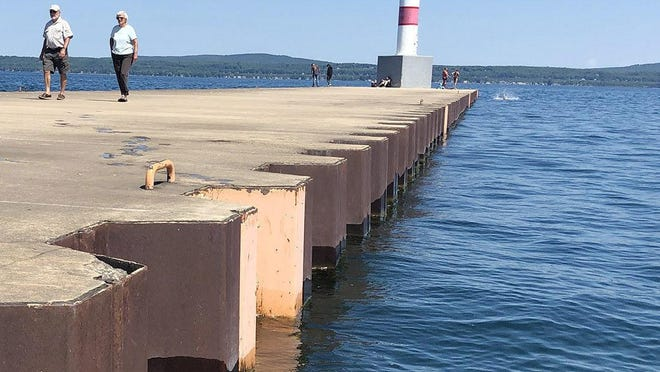 Jumping off the Petoskey breakwater, a popular summertime activity for Northern Michigan residents and visitors, offers only a little more than a three-foot drop this year thanks to record high Great lakes water levels.