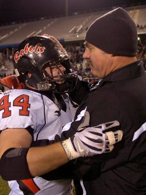 Maryville defensive coordinator Jim Gaylor consoles senior Luke Cox after the Class 4-A state championship game on Dec. 6, 2008, in Murfreesboro. Gaylor, the longtime former Maryville defensive coordinator who helped the Rebels achieve unprecedented championship success, has been hired at Clinton as a part-time assistant/adviser on new coach Randy McKamey's staff.