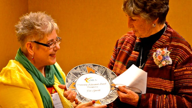 Lynette Schurdevin with Capitan Public Library Dierctor Pat Garrett.