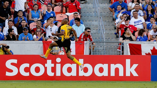 Rodolph Austin of Jamaica celebrates his goal in stoppage time against the Canada at BBVA Compass Stadium