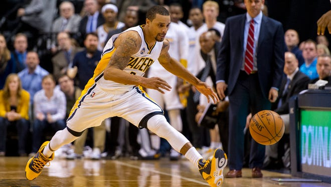 Indiana Pacers guard George Hill chases down a loose ball during the overtime period of an NBA basketball game against the Denver Nuggets on Saturday, Jan. 30, 2016, in Indianapolis. The Pacers won 109-105. (AP Photo/Doug McSchooler)