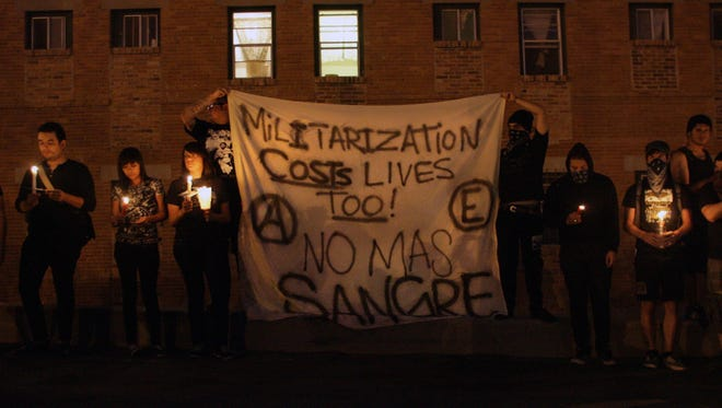 Protesters in El Paso held a candlelight vigil in June 2010 following the cross-border killing of a Mexican teenager by a U.S. Border Patrol agent.