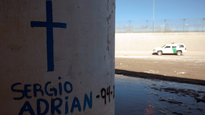 A cross was drawn on one of the walls below the Paso del Norte Bridge, where Sergio Adrián Hernández Güereca, a teenage boy from Juárez, was shot and killed by a Border Patrol agent June 7, 2010. An attorney for the family filed a lawsuit against the U.S. government on behalf of the boy's parents. It has been dismissed.