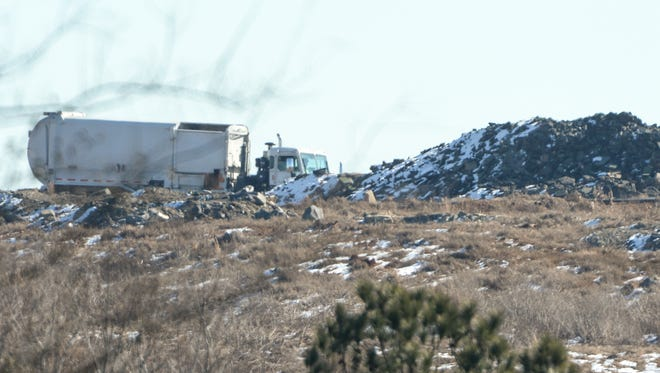 Trash trucks deliver refuge, as seen from Big Creek Road, at the Anderson Regional Landfill in Belton on January 19, 2018.