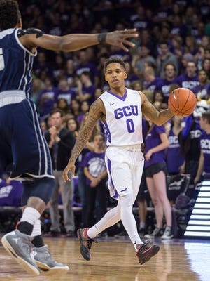 GCU's DeWayne Russell (0) dribbles up court against Paris Collins (5) in the first half at GCU in Phoenix, Ariz. on Thursday, March 17, 2016.