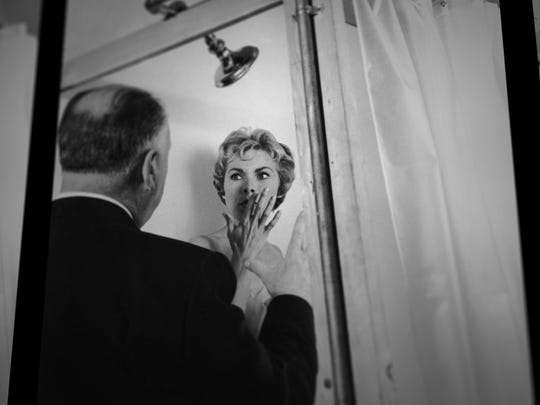 "Alfred Hitchcock and his star Janet Leigh on the set of ""Psycho."""