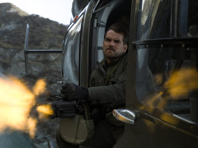 """Henry Cavill fires his machine gun in """"Mission: Impossible"""