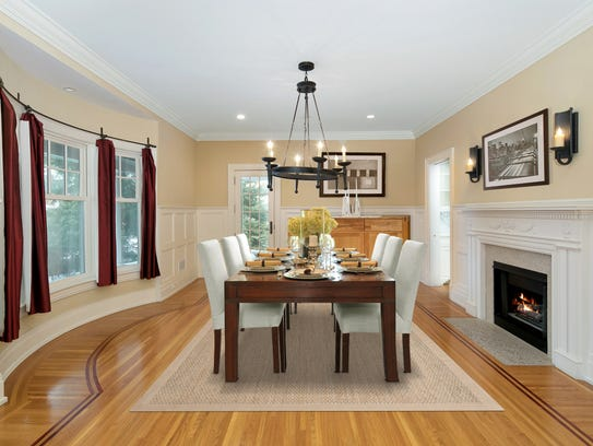 The dining room features Bay window, decorative  molding,with