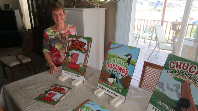 Patricia Thorpe poses with her three books, geared toward teaching children lessons, such as how to be kind to each other.