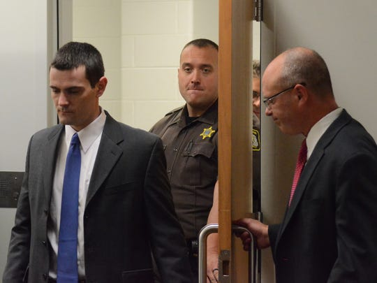 As his attorney, Brandon Hultink, holds the door, Stephen Getter enters the courtroom Thursday.