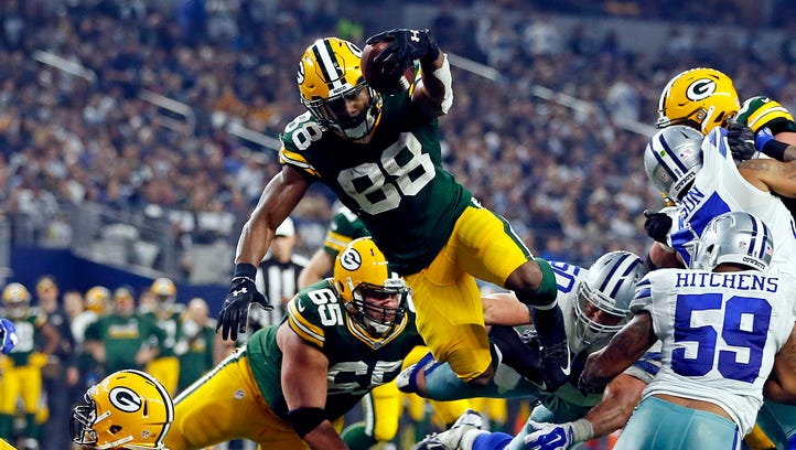 Green Bay Packers running back Ty Montgomery (88) dives for a touchdown during the second quarter against the Dallas Cowboys in the NFC Divisional playoff game at AT&T Stadium.