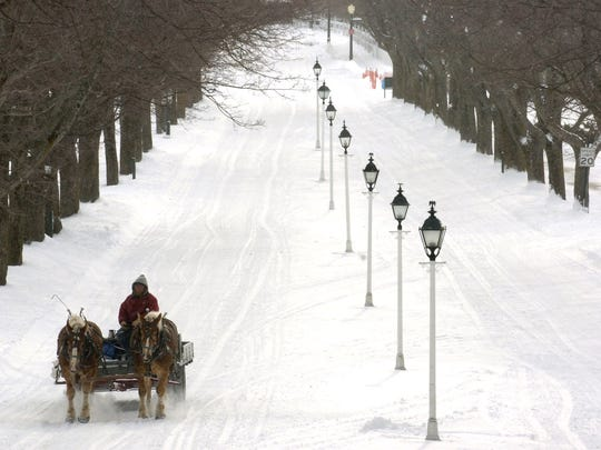 A dray driver negotiates a snowy road on Mackinac Island
