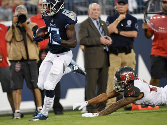 Titans wide receiver Taywan Taylor (13) leaves Buccaneers