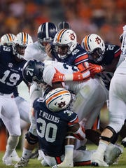 Auburn linebacker Tre' Williams (30) and Auburn linebacker