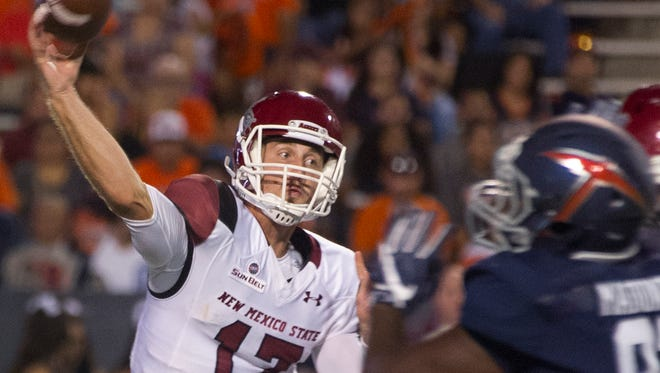 New Mexico State quarterback Tyler Rogers throws a pass Saturday night against UTEP at the Sun Bowl in El Paso.