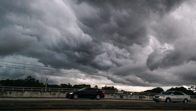 Storm clouds can be seen from Minton Road at I-95 as severe weather builds in Brevard County.