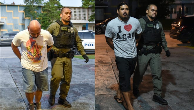 A Guam Police Department officer walks two suspects into the Hagatna Precinct on Sept. 24, connected to an attempted robbery of an Ordot game room in April. From left are Patrick Sablan, 38, of Agat, and Thomas Cruz, 29, of Harmon, according to GPD.