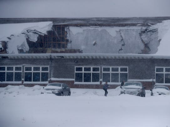 Wisconsin Weather Roof Collapses Floods Remain Concerns