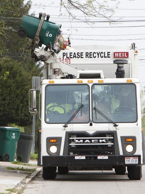 A woman was killed Wednesday after she crashed into a Rumpke garbage truck.