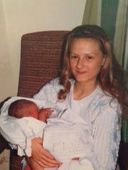 He was born at Christmas, Sarah with her new brother.