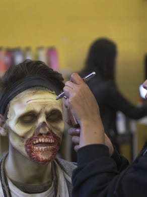2014: Jade Brown of Princeton works on the makeup of Chris Cianci of Jackson as Six Flags Great Adventure Staff gear up for another Fright Night during their Fright Fest event.