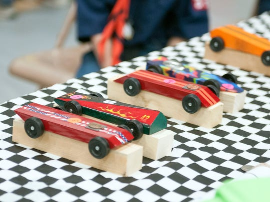 The Eagle Bay District's annual Pinewood Derby featured 125 Cub Scouts from Sandusky and Ottawa counties racing their homemade cars at Genoa Area High School on Sunday.