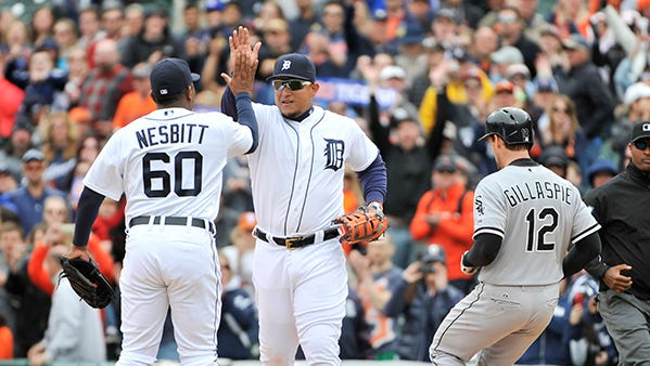 Angel Nesbitt and Miguel Cabrera high-five after the final out Sunday.