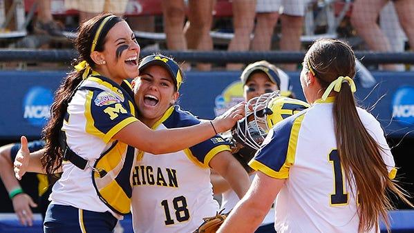 Catcher Lauren Sweet, left, third baseman Lindsay Montemarano, center, and pitcher Haylie Wagner celebrate Michigan's win over LSU.