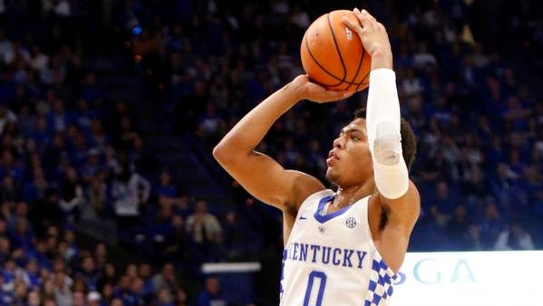Kentucky's Quade Green (0) takes an uncontested shot during the first half of an NCAA college basketball game against East Tennessee State, Friday, Nov. 17, 2017, in Lexington, Ky.