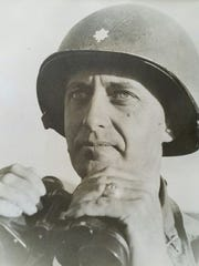 A Korean War era photo of Brig. Gen. Miller Perry shows his original West Point ring on his left hand. The ring, lost more than three decades ago, was found Sunday, Sept. 25, 2016,  in an East Lansing yard.