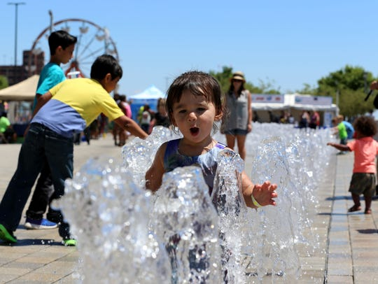 Evelyn Roscoe of Dearborn enjoys the water at the Fountains
