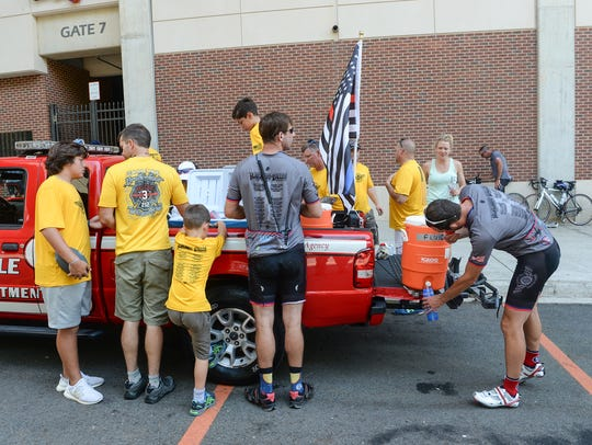 A group of 30 first responders stop at Memorial Stadium
