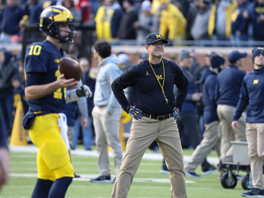 Michigan head coach Jim Harbaugh watches his players
