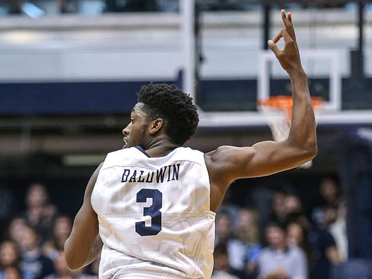 Butler Bulldogs guard Kamar Baldwin (3) celebrates after scoring a three-point shot during second half action between the Butler Bulldogs and the Saint Louis Billikens at Hinkle Fieldhouse, Indianapolis, Saturday, Dec. 2, 2017. Butler crushed Saint Louis, 75-45.