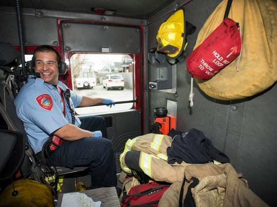 Port Huron firefighter Peter Lafata laughs at a joke