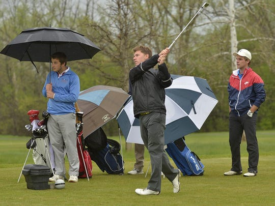 Plymouth's Kyle Kozler watches his tee shot Tuesday