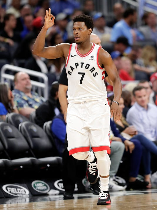 Toronto Raptors' Kyle Lowry (7) celebrates a 3-point shot against the Orlando Magic during the second half of an NBA basketball game, Tuesday, March 20, 2018, in Orlando, Fla. (AP Photo/John Raoux)