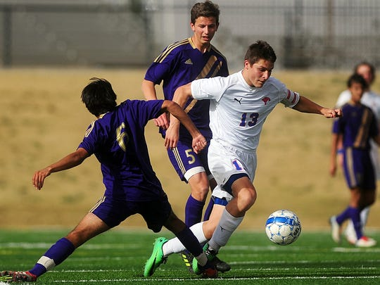 Cooper High's Luke Lopez (13) is tripped up by Midland's Gustavo Ramirez (6) during the first half of their game Tuesday, March 18, 2014 at Shotwell Stadium.