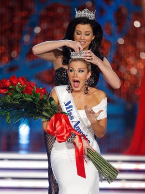 Miss New York Mallory Hagan is crowned Miss America 2013 by Miss America 2012 Laura Kaeppeler on Jan. 12, 2013.