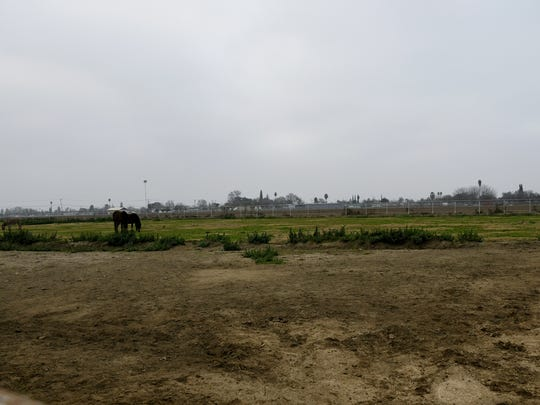 The field adjacent to the current Tulare High School Farm main building is the site for the new classroom and administration building.
