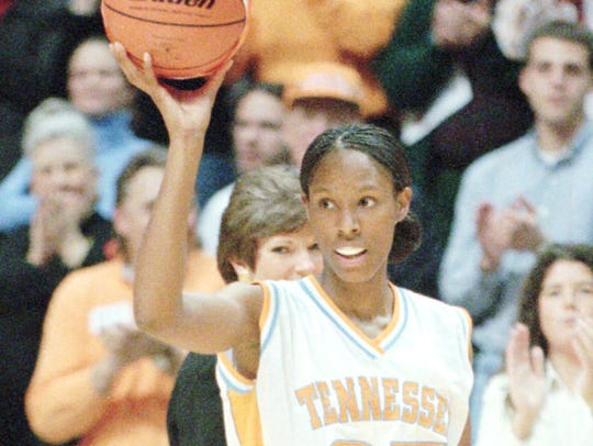 Tennessee's Chamique Holdsclaw holds up a ceremonial