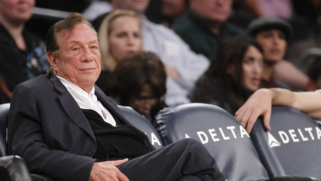 In this Monday, Dec. 19, 2010 photo, Los Angeles Clippers owner Donald Sterling watches the second half of an NBA preseason basketball game between the Los Angeles Clippers and the Los Angeles Lakers in Los Angeles. On Saturday, April 26, 2014, the NBA said it is investigating a report of an audio recording in which a man purported to be Sterling makes racist remarks while speaking to his girlfriend. (AP Photo/Danny Moloshok)