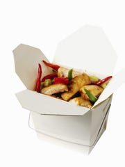 Close-up of a carton of Chinese food