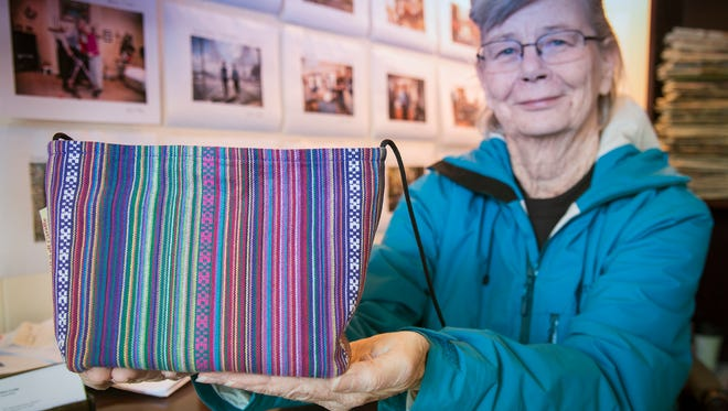 """Linda Robertson, with one of the bags she makes, wants to bring Black Mountain's """"creatives"""" together to talk shop and studio."""