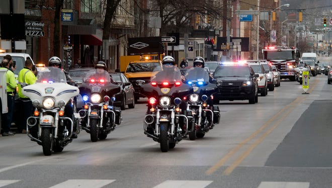 A funeral procession for York firefighter Ivan Flanscha heads south on North George Street before passing through Continental Square in York Tuesday. A public memorial for Flanscha and firefighter Zachary Anthony is planned for Wednesday at the York Expo Center.