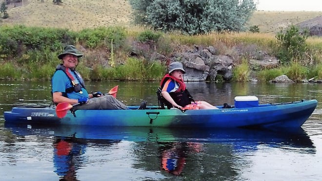 Doug (left) and Kyle Clark in a kayak near Craig south of Great Falls.