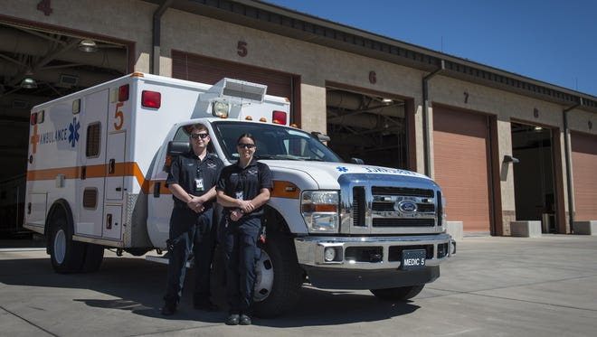 Arin Meyer, a 49th Medical Operations Squadron emergency medical technician-Basic, and Jillian Barker, a 49th MDOS paramedic, pose for a photo outside the fire station for National Emergency Medical Services week at Holloman Air Force Base, N.M. on May 17, 2017. National EMS week was established in 1974, as a means to honor EMS practitioners and their contributions to families and communities across the United States. Licensing to become an emergency medical technician requires formal training at the EMT-Basic, EMT-Intermediate or EMT-Paramedic level. Training programs are offered at emergency medical service academies and other educational institutions.