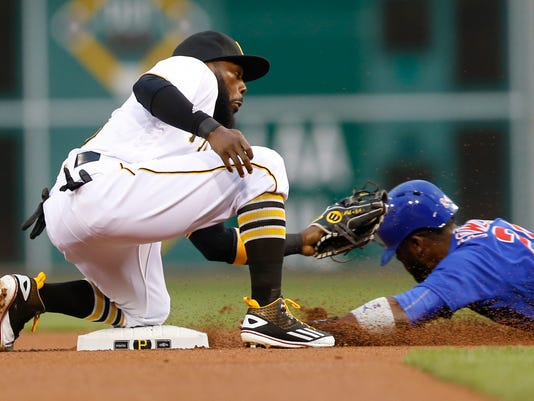 Pittsburgh Pirates second baseman Josh Harrison, left tries to tag Chicago Cubs' Dexter Fowler steals second in the first inning of a baseball game, Monday, May 2, 2016, in Pittsburgh. (AP Photo/Keith Srakocic)