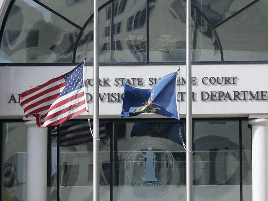 Flags fly at half-staff at the M. Dolores Denman Courthouse in honor of Louise Slaughter. Slaughter, a longtime congresswoman from Fairport, died Friday at the age of 88.