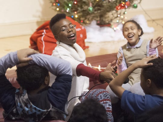 Vedra Chandler sings Christmas songs with children at the Neighborhood Center in Camden. The vocalist stars in the next show at Ritz Theatre Company in Haddon Township.